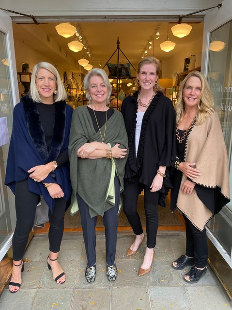 From left to right: SarahVan Stone of Cashmere for a Cause, Starr Osborne of Tailored Home, incoming LBBC board chair   Megan Rutt and Free Reign co-founder Gigi Kitei model some of the cashmere and jewelry that will be featured at Tailored Home Oct 21.