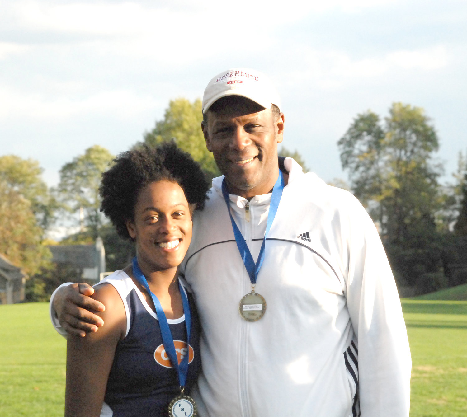 GFS Tennis Coach Chris Booth and his daughter, Johanna.