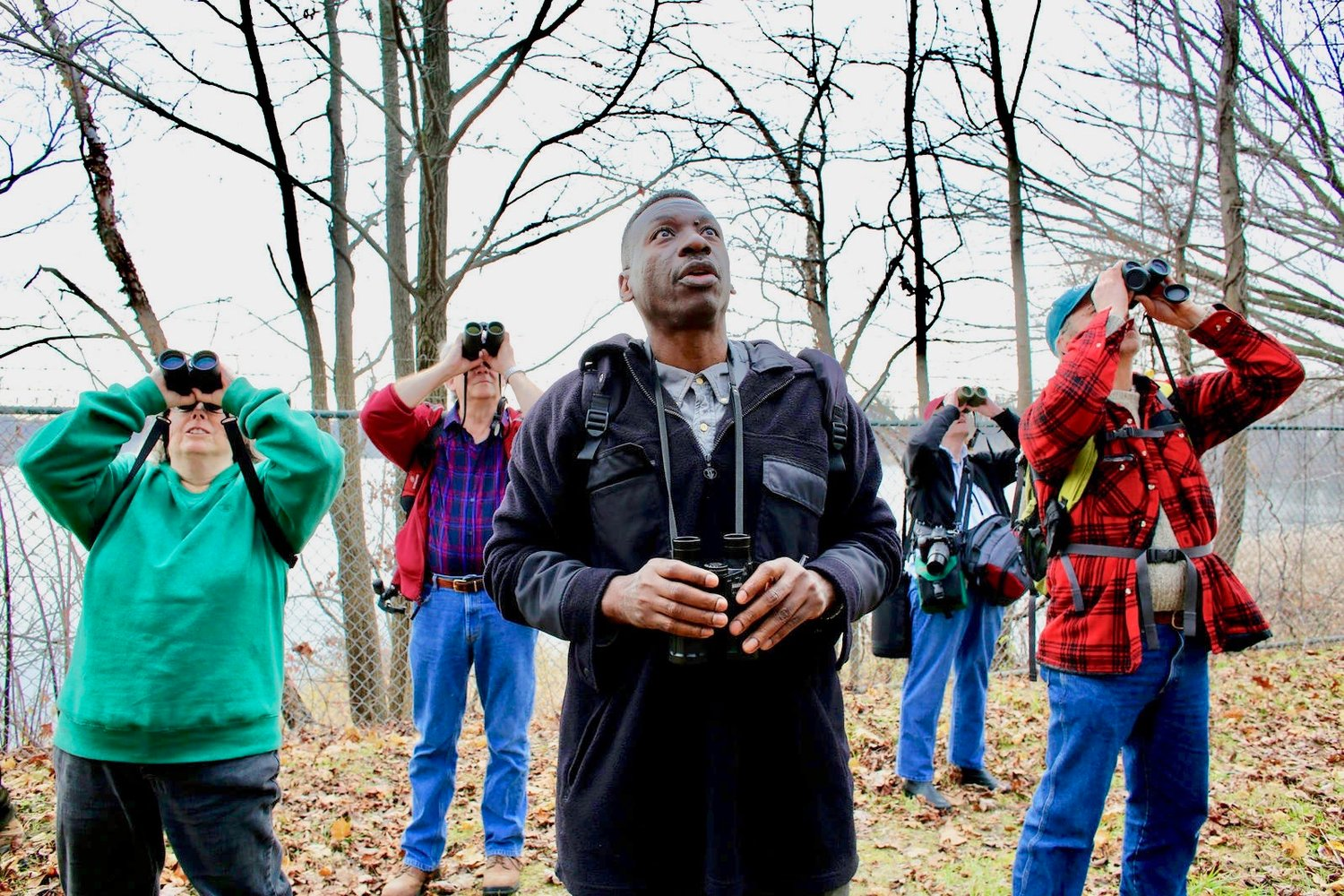 Keith Russell (center), who grew up in West Mt. Airy but now lives in Germantown, is seen here bird-watching with fellow members of the National Audubon Society. An ornithologist, Russell is program manager of Urban Conservation at Audubon Pennsylvania. (Photo courtesy of National Audubon Society)