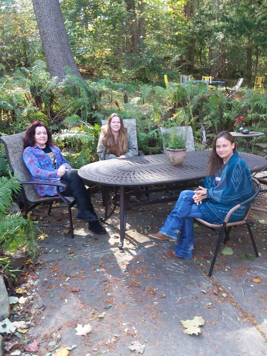 Mary Skarbek (from left), Morgan Wells and Jen Merritt enjoy a lovely day in the park at Cedars House, a historic property at 200 W. Northwestern Ave. on Forbidden Drive. (Photo by Stacia Friedman)