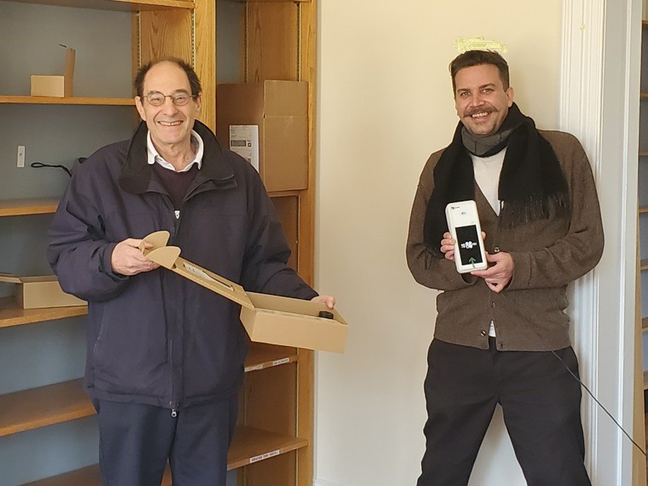 Stan Cutler and James Gleeson with the Friends of the Chestnut Hill Library Book Store's new point-of-sale terminal.