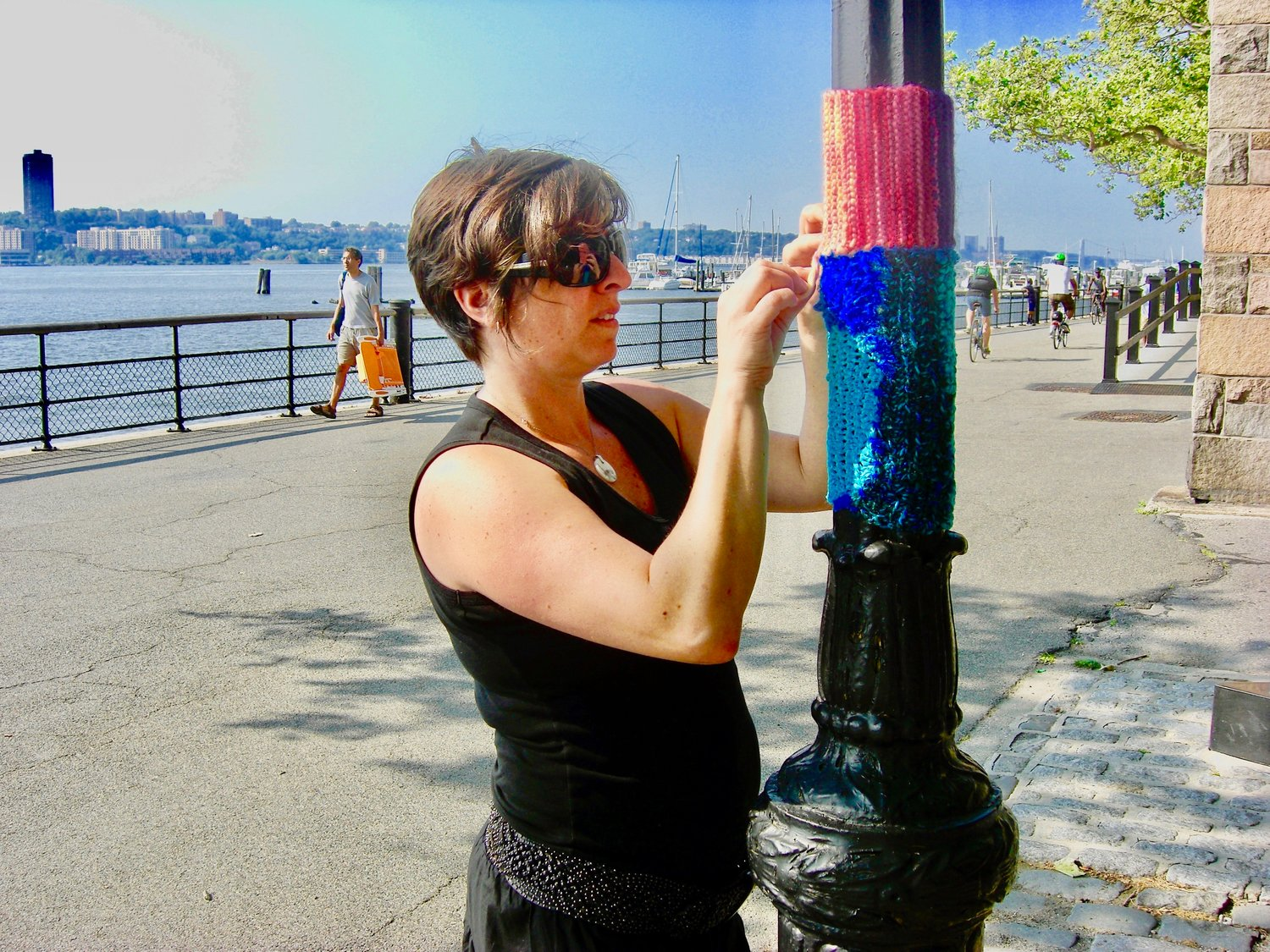 "Haims is known for her ""yarnbombing,"" the covering of objects or structures in public places with decorative knitted or crotcheted material, as a form of street art. Melissa has done this on telephone poles and trees on Chestnut Hill streets."
