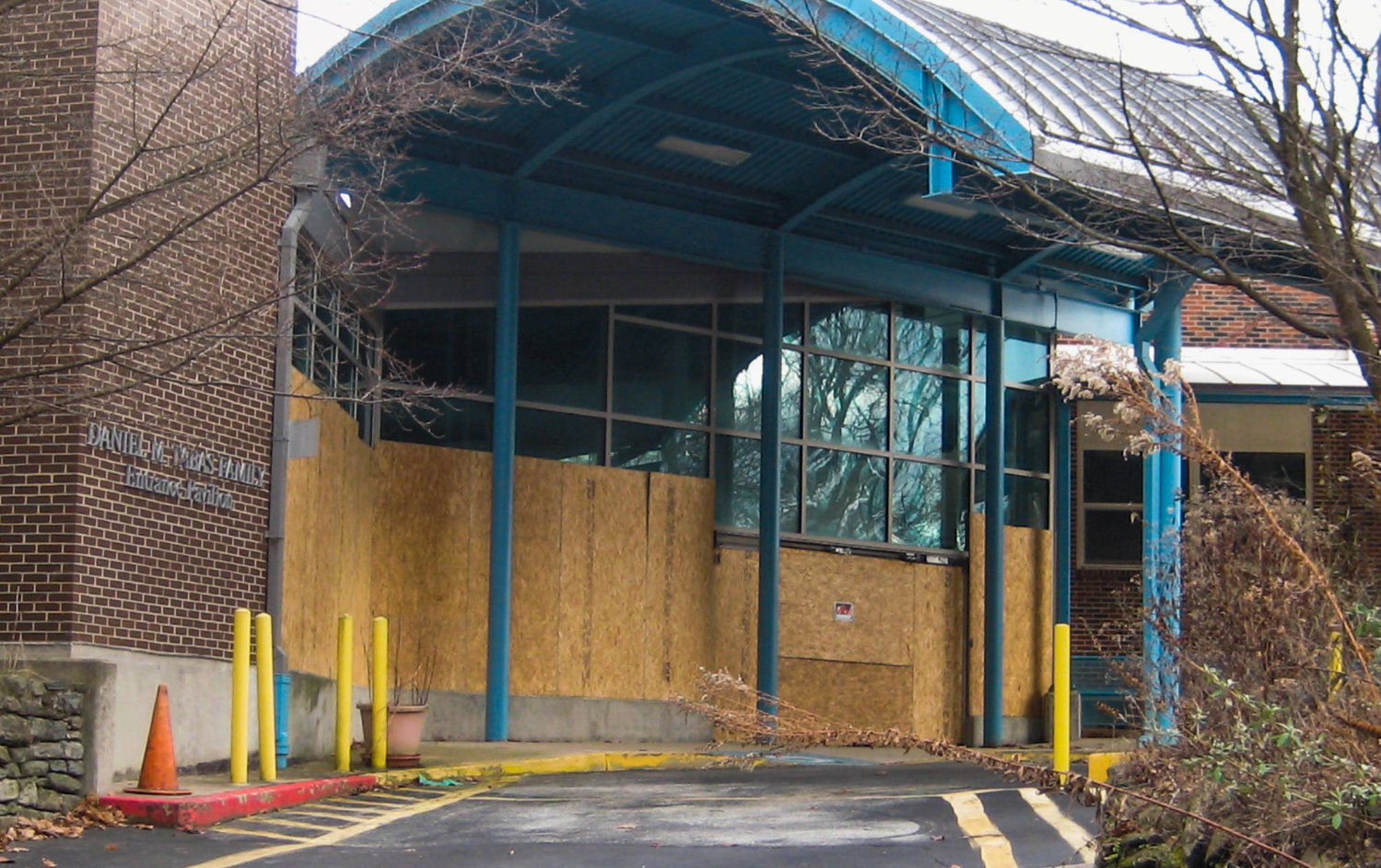 By Thursday, January 7, the Goldenberg Group had responded with a sitewide cleanup and on-site security. Those measures included sealing broken glass at the building's front entrance.