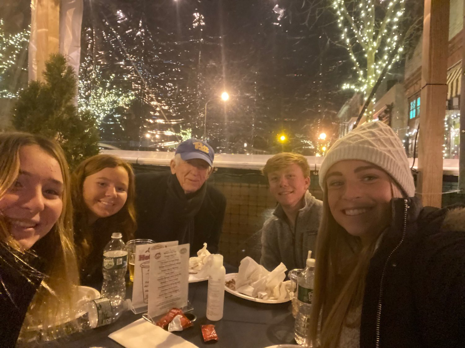 The Maher family dines in the outdoor tent recently at McNallys.