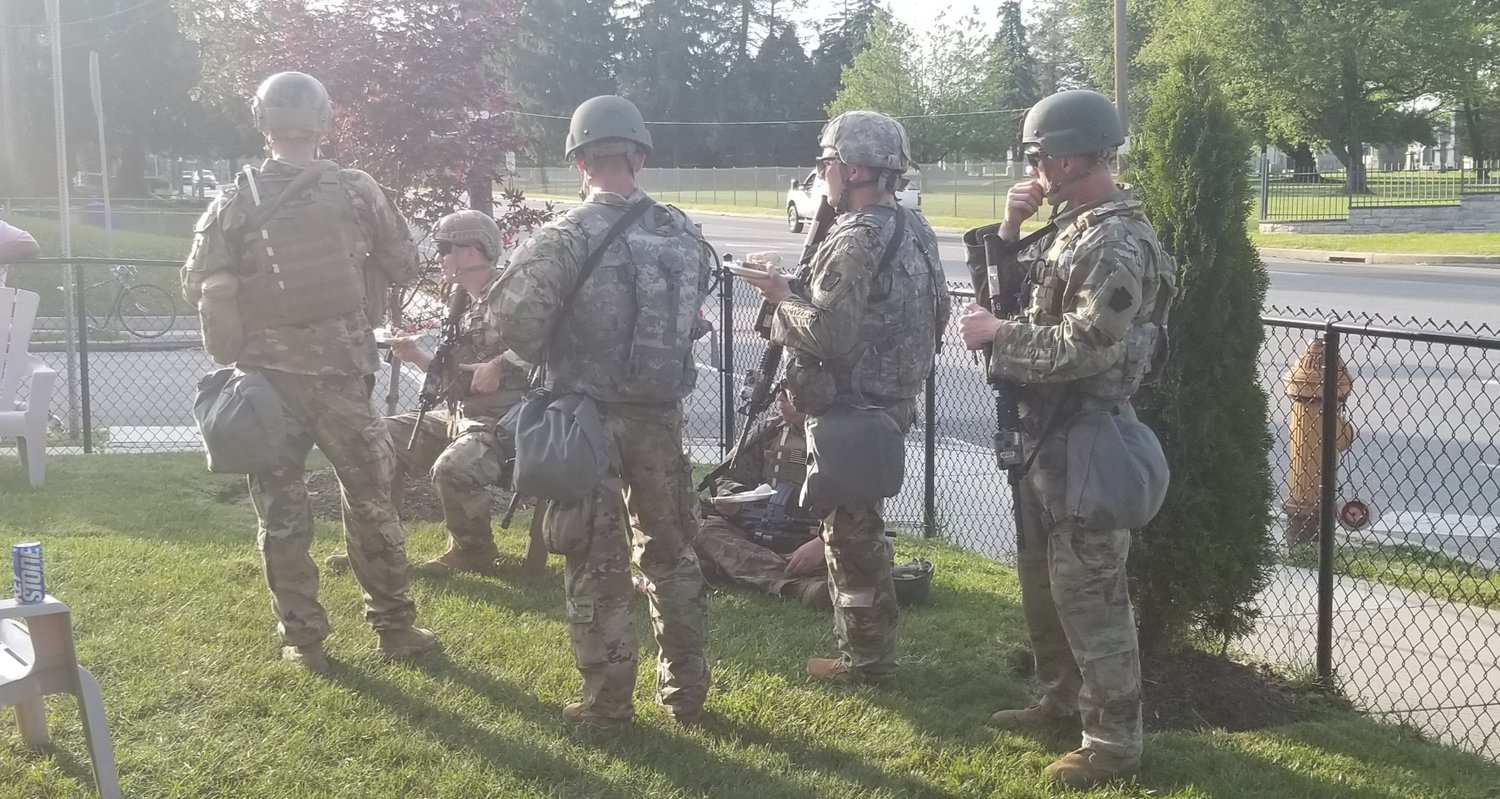 "A group of white National Guardsmen from Western Pennsylvania enjoyed some ""rib diplomacy"" in a mostly Black neighborhood in Mt. Airy last May after extensive unrest in Center City and several Philadelphia neighborhoods following the killing George Floyd. (Photo by Frederic Schley)"