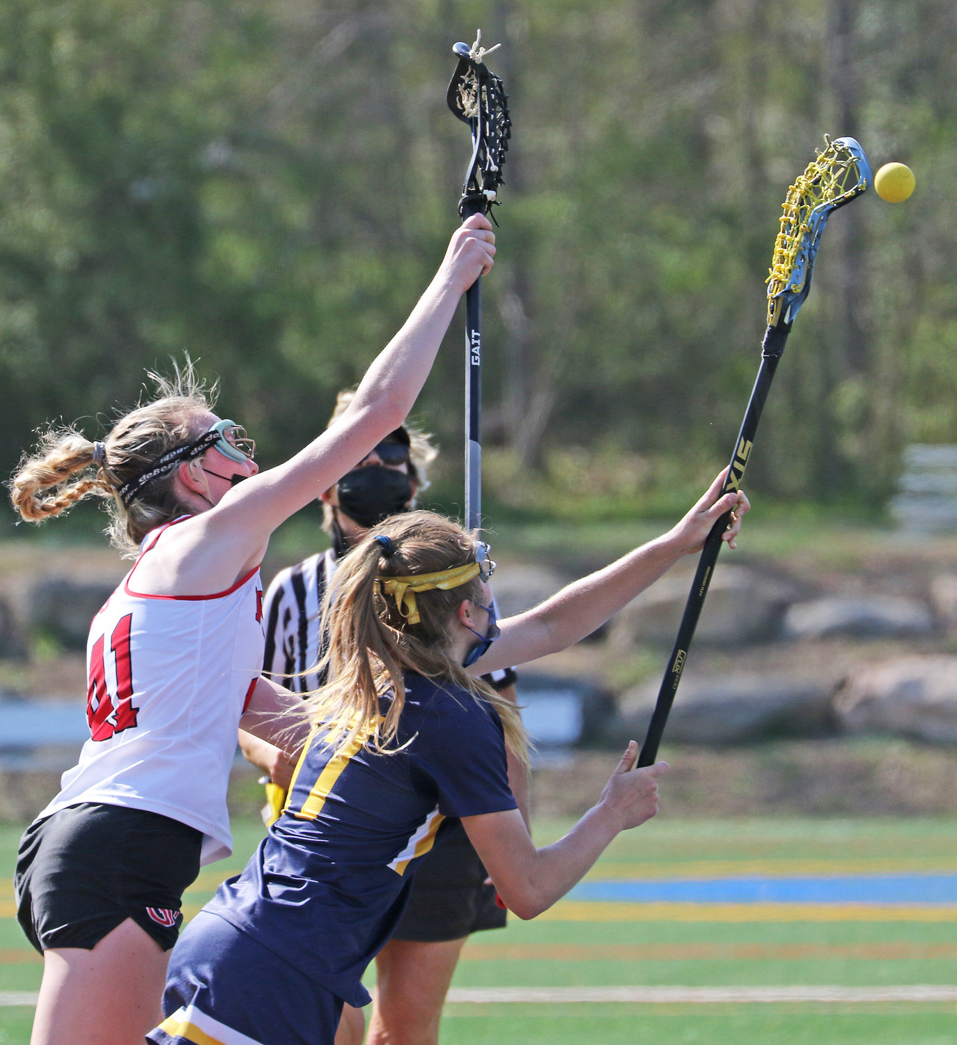 Penn Charter junior Charlotte Hodgson (right) wins a draw against GA freshman Emma Goodwin. Hodgson has verbally committed to Harvard University.  (Photo by Tom Utescher)