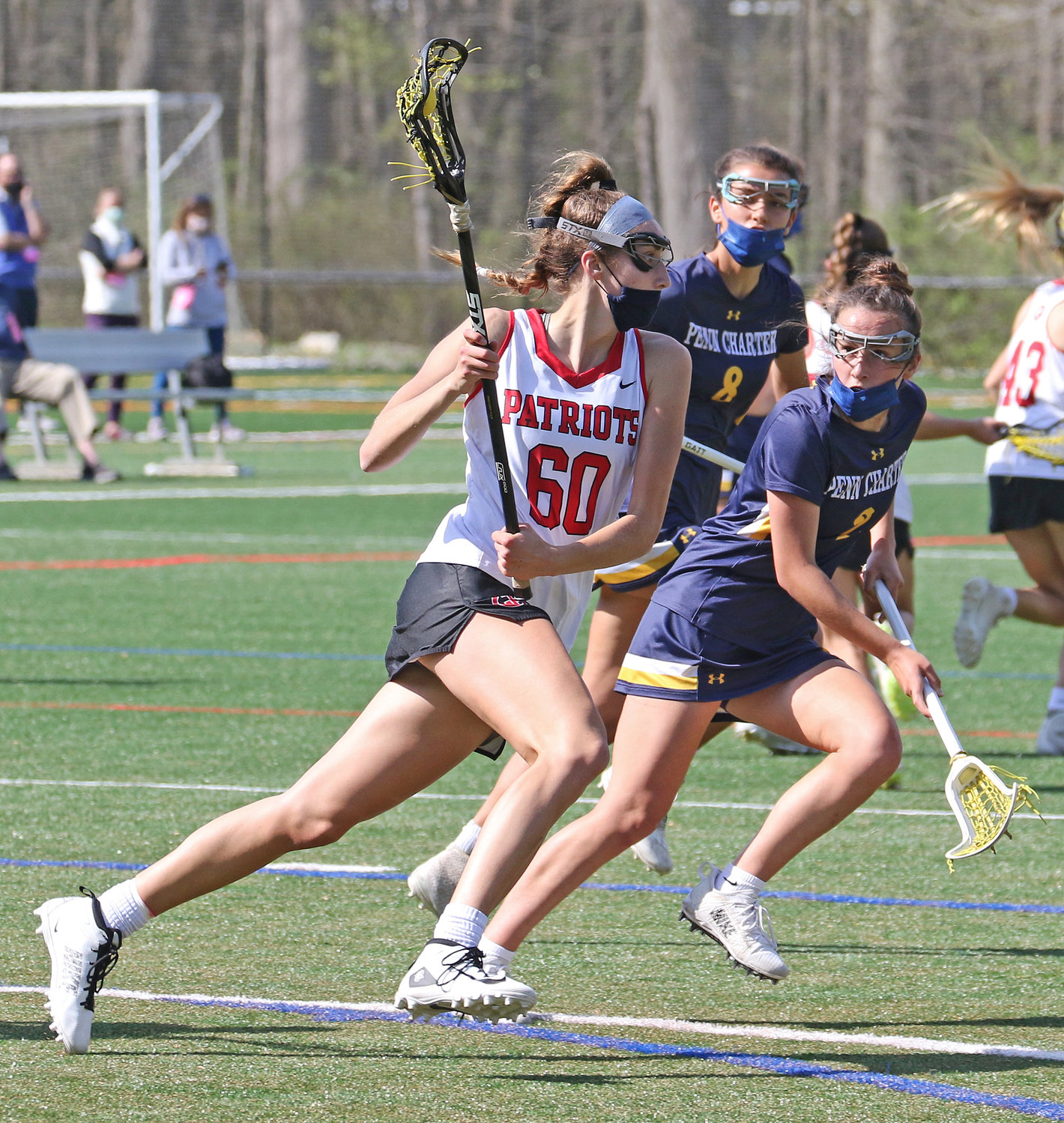 Elise Smigiel, a six-foot GA senior headed to Marquette University, opens up her stride going through the midfield as she's marked by PC's Darcy Felter, a junior committed to the University of North Carolina.  (Photo by Tom Utescher)