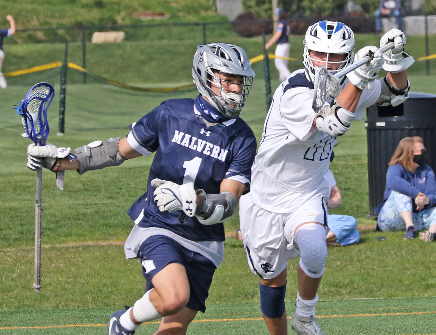 Blue Devils senior Conor Kilfeather (right) is about to bring his stick across in front of Malvern's Nick Potemski in an effort to dislodge the ball. Potemski would avoid the check.  (Photo by Tom Utescher)