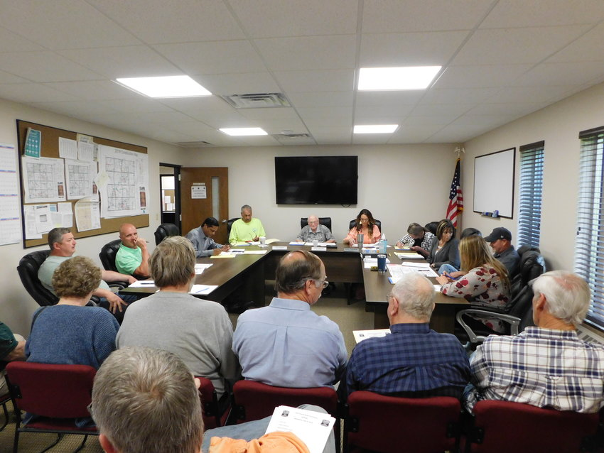 The Clare County Road Commission Board gets down to business at its June 5 meeting. Pictured, from left, are David Bondie, assistant road maintenance foreman; Aric McNeilly, road maintenance foreman; Deepak Gupta, managing director/engineer; Tim Haskin, vice chair; Richard Haynack, chair; Karen Hulliberger, member; Angelina Barnes, attorney; Kimberly Kimmel (Jones), finance director/board secretary; and Allan Leonard, engineering technician.
