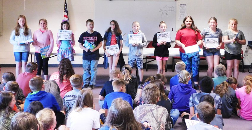 These fifth-graders show off their certificates of honorable mention. The art of these students also will be included in the 2020 calendars.