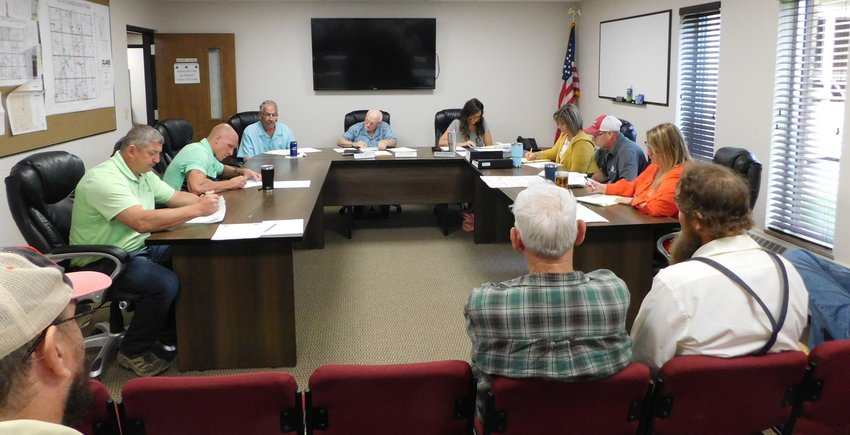 The Clare County Road Commission Board prepares to tackle the day's agenda at its July 2 meeting.
