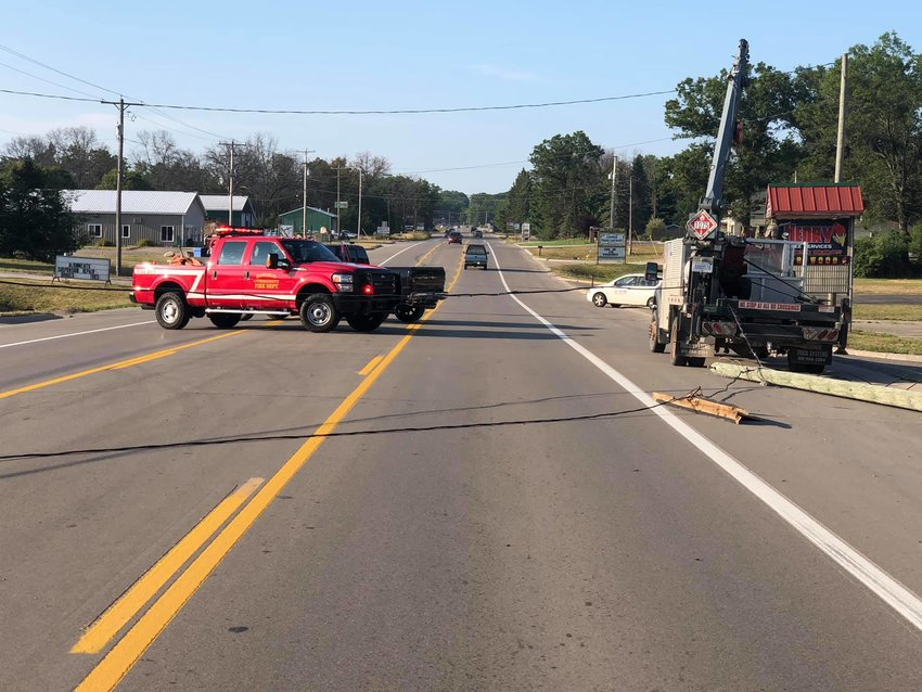 A Ziehm LP Gas truck is shown Monday, Aug. 5 after snagging a power line on N. Clare Avenue with the entangled power line and pole dragged out behind it.