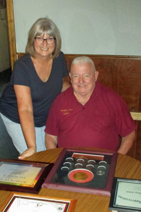 Donna Merritt and Bill Murray look at some of the awards the Harrison Lodge won at the state conference.