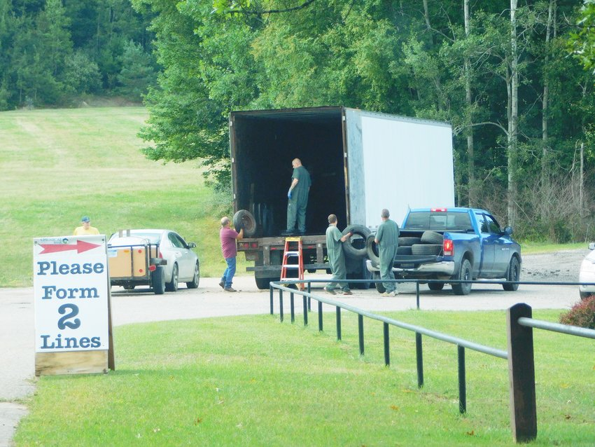 """Once again, some of the """"guests of the county"""" lent a hand at the tire drop-off, helping to haul and hoist tires – a truly dirty job – and their help was truly appreciated."""