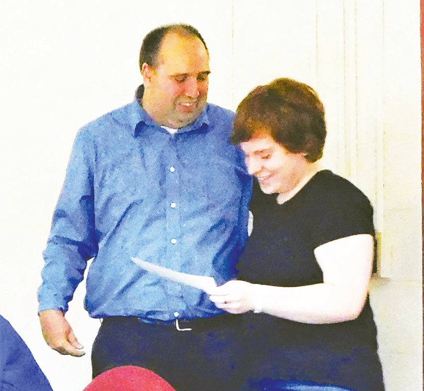 During the Oct. 14 meeting of the Harrison Community Schools Board of Education, Harrison High School musician Carley Young gets a hug from her uncle Chad Hathcock, BOE treasurer, after awarding her a certificate recognizing her musical accomplishment.