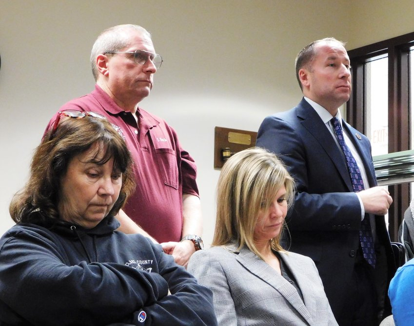 Jerry Becker, standing left, and Orville Theaker respond to additional questions from the board during the Dec. 18 meeting of the Clare County Board of Commissioners. Also pictured are Rudi Hicks, Animal Control director, and Jenny Beemer-Fritzinger, county treasurer.