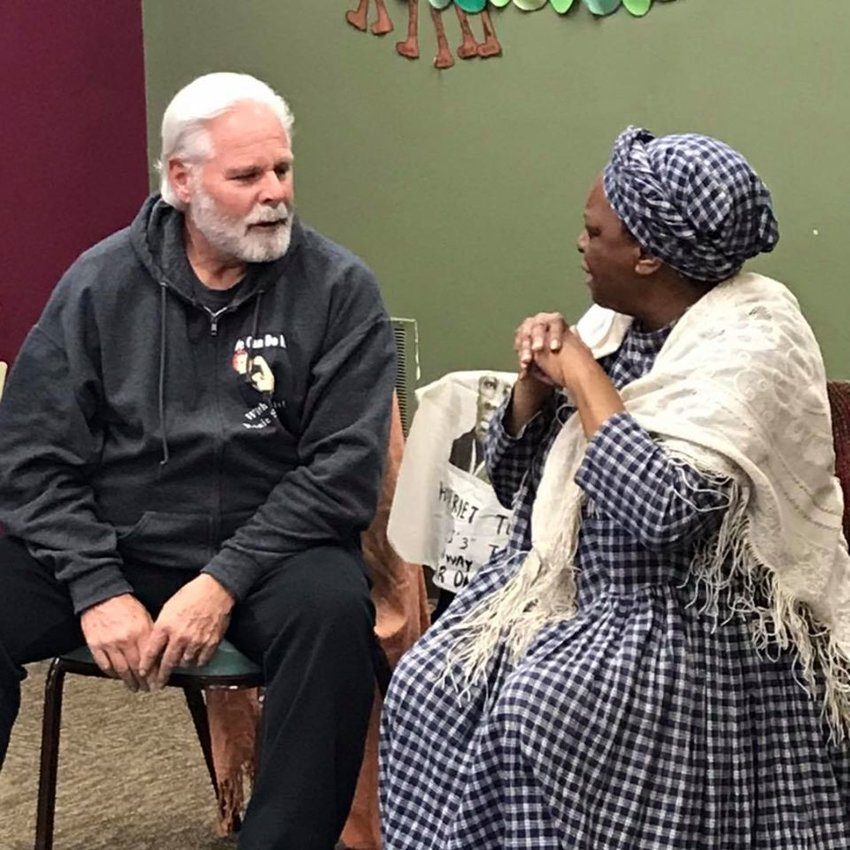 """Hayes township trustee Mike Haley sits in as """"Daddy"""" to Harriet Tubman and comes up with mostly the right answers during his impromptu role in storytelling at the Harrison District Library."""