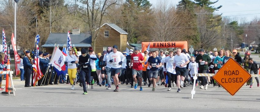 Runners break away from the start line during the 2019 Annual Freedom 5K Run/Walk in Harrison. This year's event has been turned into a virtual run due to the constraints imposed by the COVID-19 pandemic.