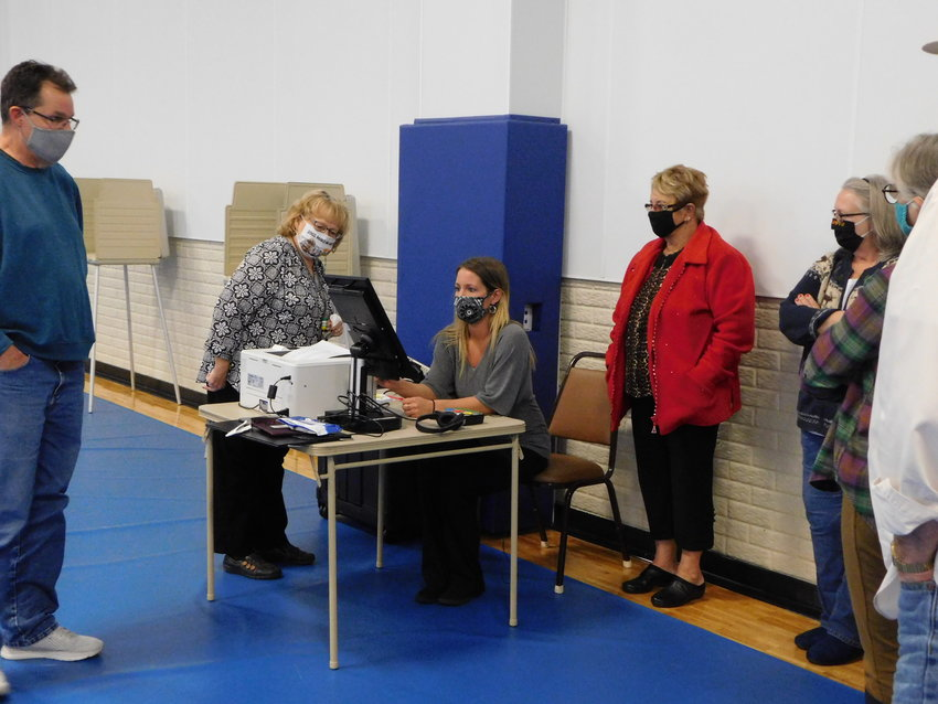 Election workers at Hayes Township learn how to operate a Voter Assist Terminal during an Oct. 26 rehearsal in preparation for the Nov. 3 general election.