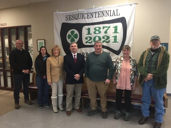 During the BOC's March 17 meeting, St. Patrick's Day, a Sesquicentennial flag was presented to commissioners on behalf of the Clare County Historical Society by CCHS President Dennis Carbeno, far right. Commissioners pictured, from left are Rick Fancon, Samantha Pitchford, Bronwyn Asplund, Dale Majewski, Jeff Haskell and Sandra Bristol.