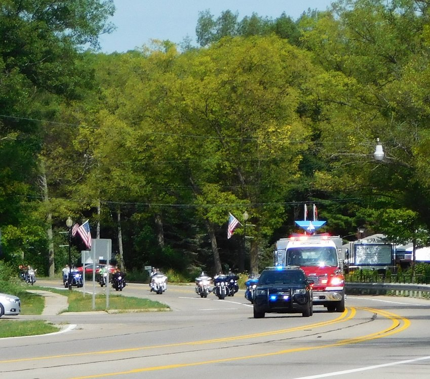 Law enforcement vehicles escort, Freedom Ride 2018 motorcycles and passenger vehicles shown stretching from the top of James Hill to Dover Road as the Ride began. Participants in Freedom Ride 2020 are shown making the first turn south out of Harrison. Freedom Ride 2021 is slated for July 17, and is expected to be a well-attended event, full of camaraderie and fun, with the goal of funding the next Veterans Freedom Park statue honoring veterans of Desert Storm.