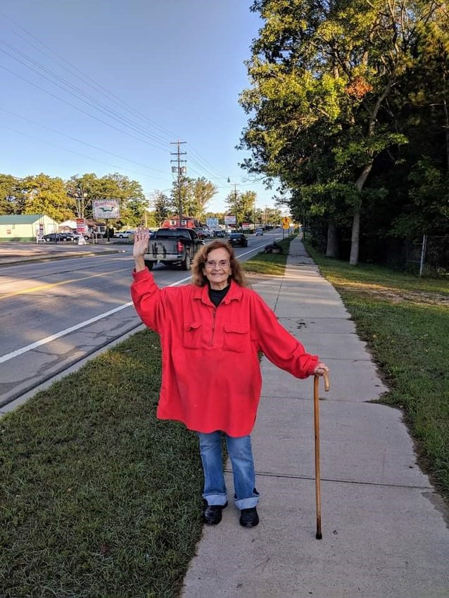 The family of Red, the Waving Lady, shared the following two articles in lieu of an obituary.