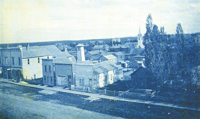 """The original Cleaver office (left) on Main Street in Harrison in the 1890s. The top of the building reads """"Cleaver Office."""" The office today is less than a few hundred yards from the original location."""