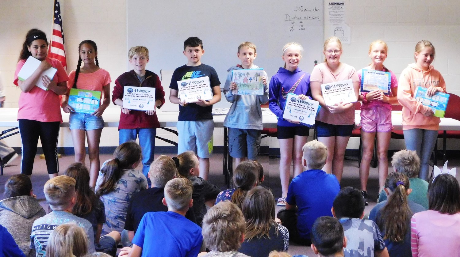 "These Hillside Elementary School fifth-graders proudly display the certificates declaring them winners in the City of Harrison's calendar drawing contest, where students illustrated the theme ""Protect Our Groundwater."""