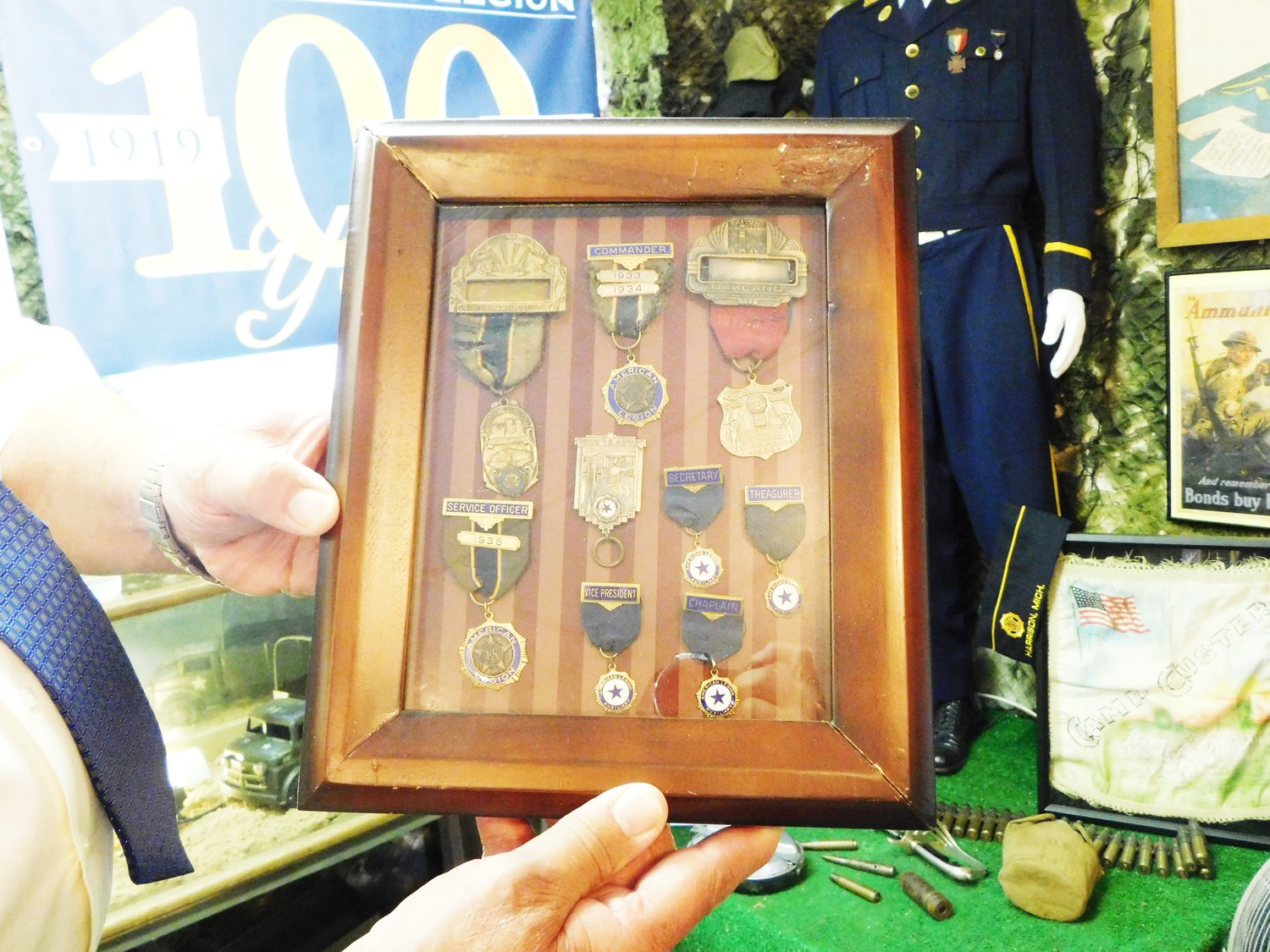 These antique American Legion insignia pins, uniforms and memorabilia shown here can only hint at the many interesting and informative items included in the Veterans Display's 100th year celebration of the American Legion.
