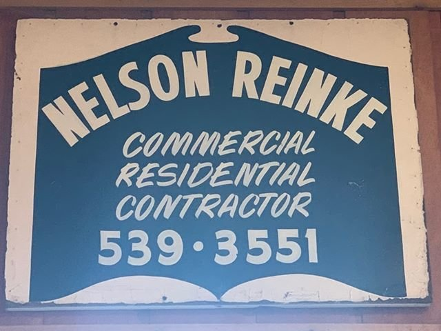 This original sign from 1975 for Nelson Reinke Construction now hangs in the gift shop area of Reinke's Hearth of the Home.