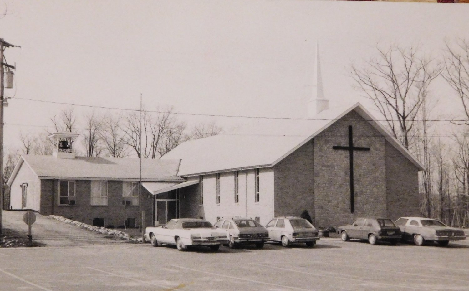 Grace Fellowship Church built in 1968.  PIctured here in 1983. The cornerstone was laid by the Rev. Carl Briggs in 1968.