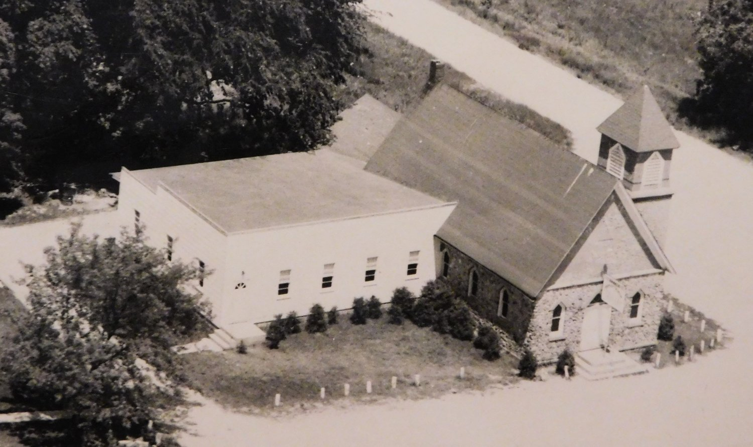 The stone facaded Skeels Baptist Church with its addition in 1983.