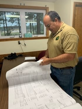 Park supervisor Andy Saxton looks over plans for the new facilities at Wilson State Park.