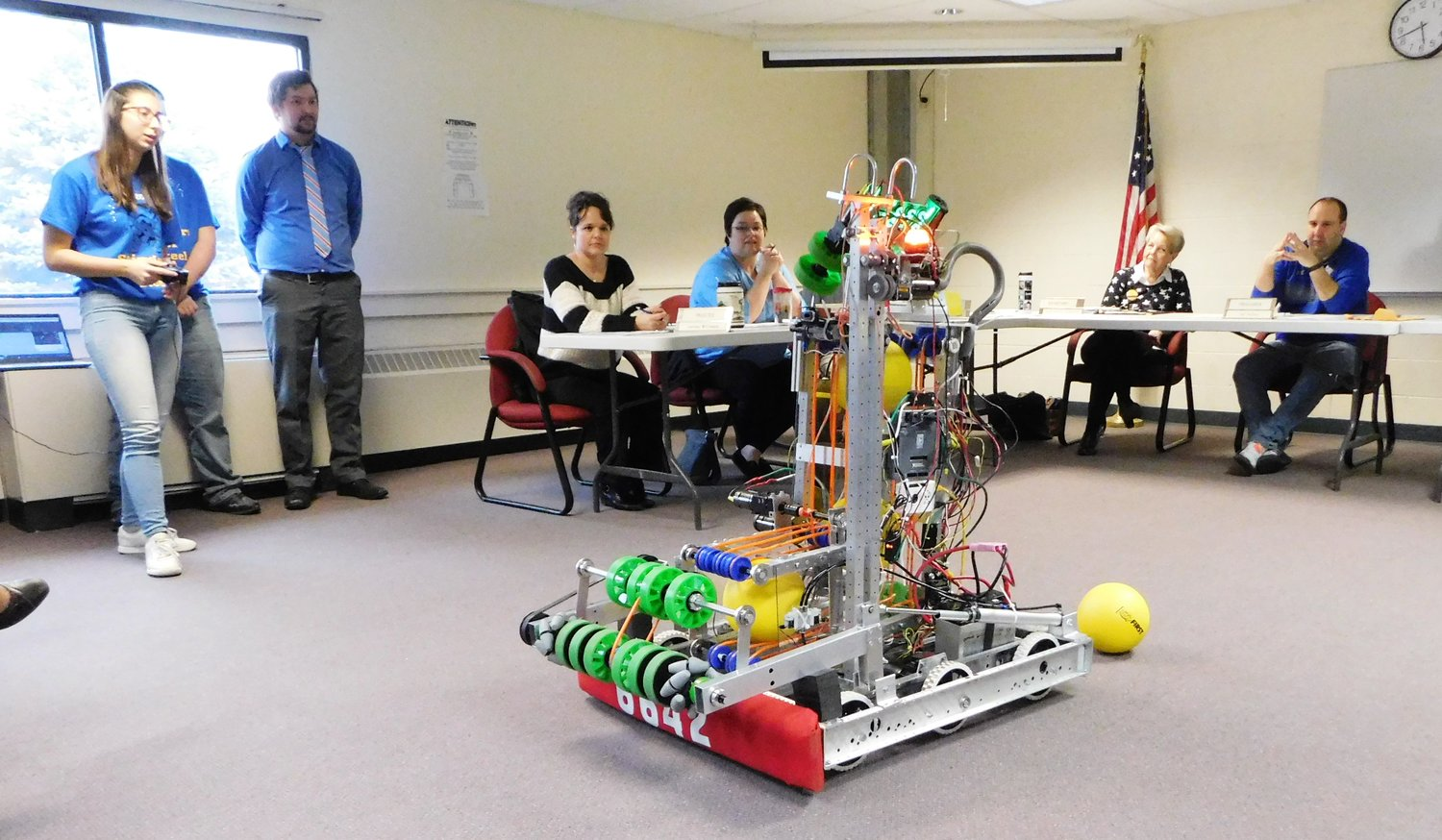 "The Harrison Hornets Stingers of Steel robotics team puts ""Lucille"" through its paces for the Harrison Community Schools Board of Education Monday evening."