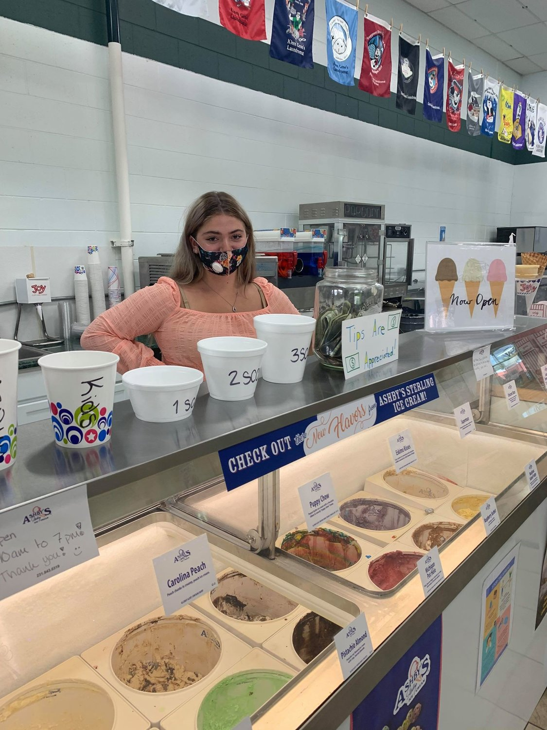 Young entrepreneur Arianna oversees the ice cream and snack bar at her family's newly acquired business, Kleen Gene's Laundromat in Harrison.