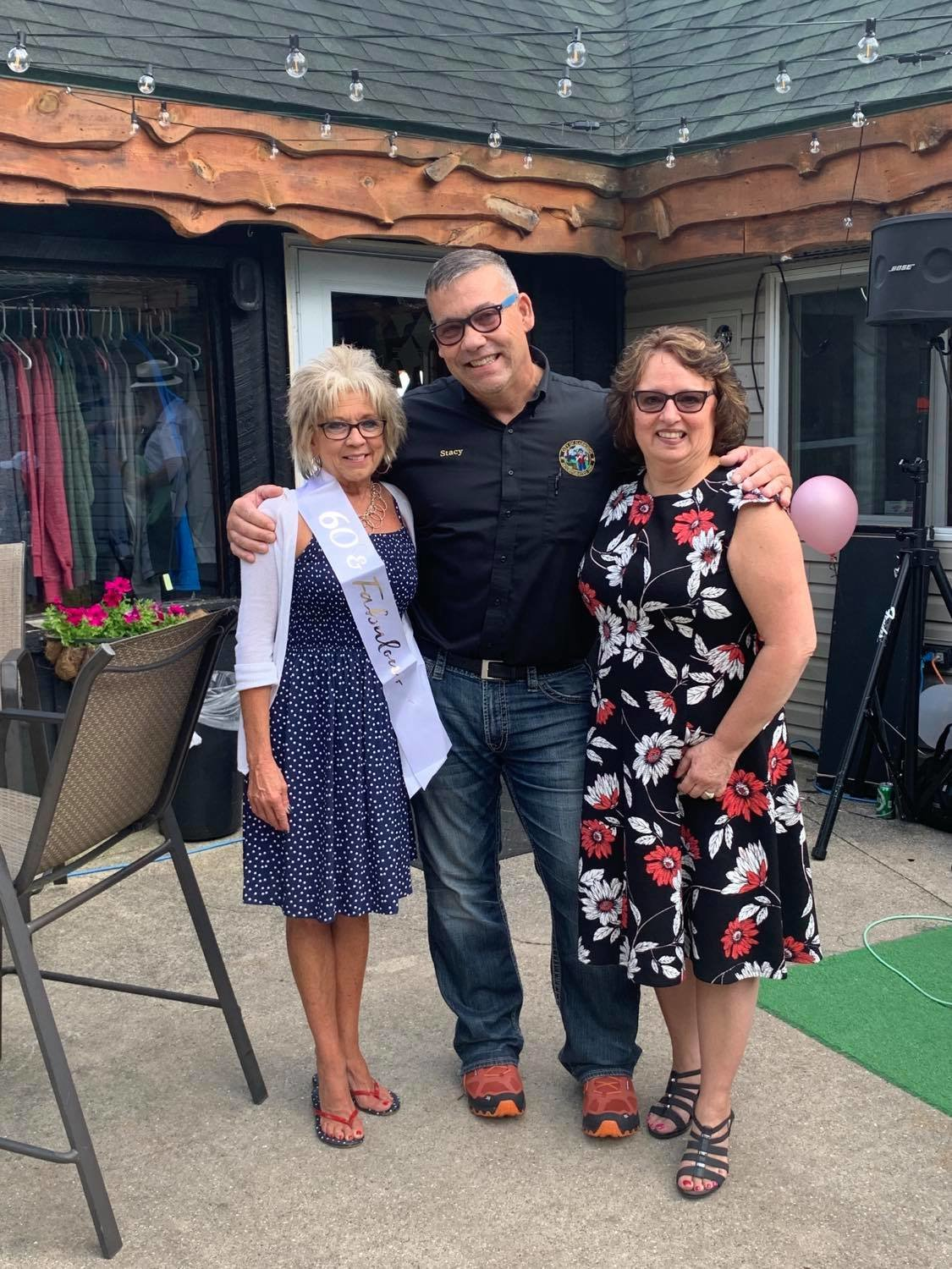 Sharon Hawkins (left) with Mayor Stocking and City Manager Tracey Connelly at her retirement/birthday celebration at Tamaracks Golf Course.