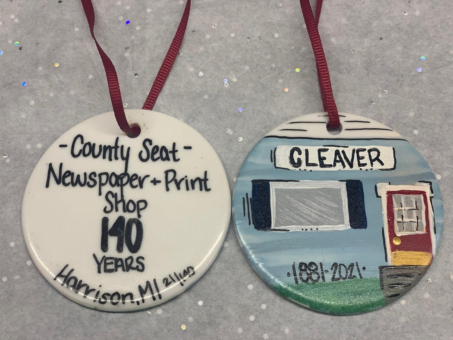 The back and front of the hand painted ornaments created by Emily Martin for the Cleaver.