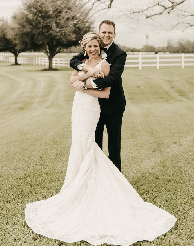 Kristen R. Dobson and Michael K. Hole exchanged wedding vows March 16 at Guardian Angel Catholic Church, Wallis, Texas.