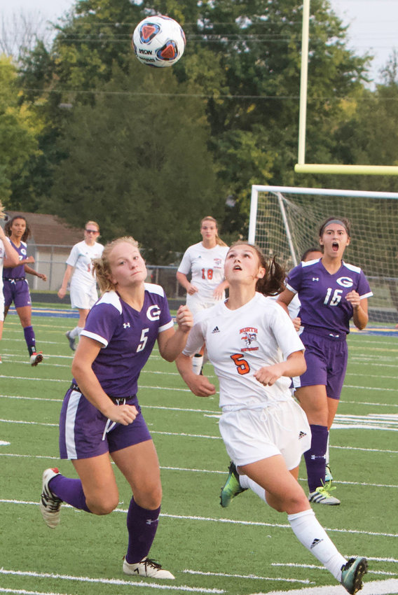 North Montgomery's Teegan Bacon fights for the ball with Greencastle's Elise Lausee.