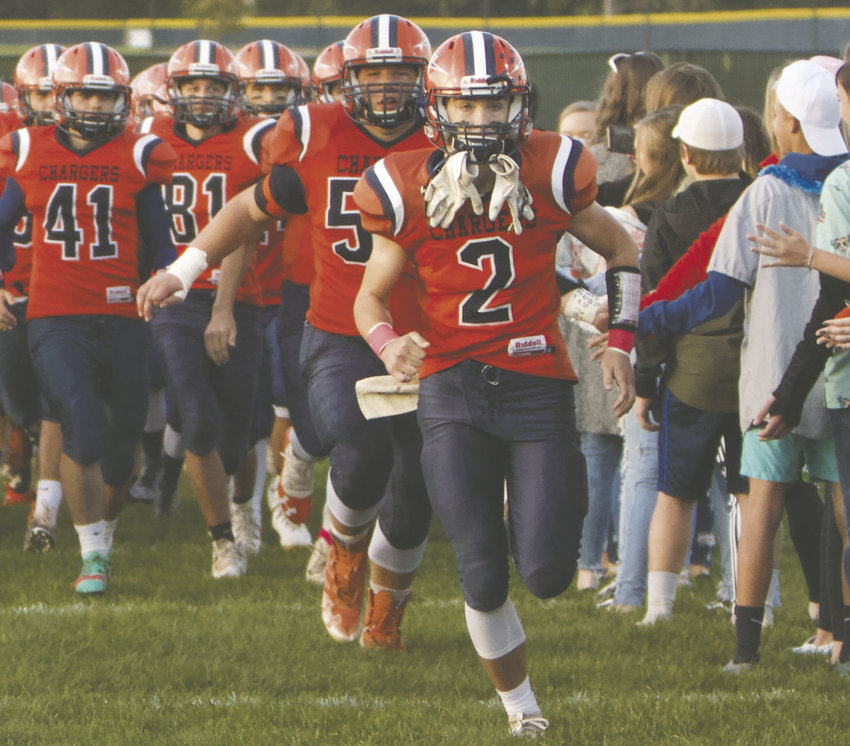 North Montgomery senior Kai Warren leads the Chargers onto the field during a home game this fall.