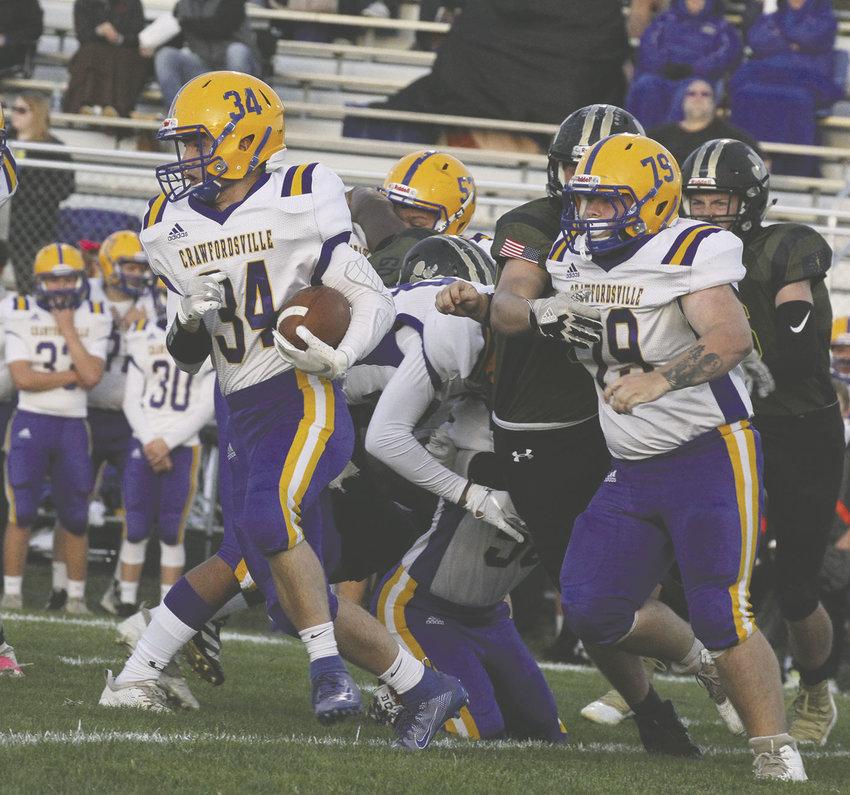 Noah Allen runs the ball for the Athenians.