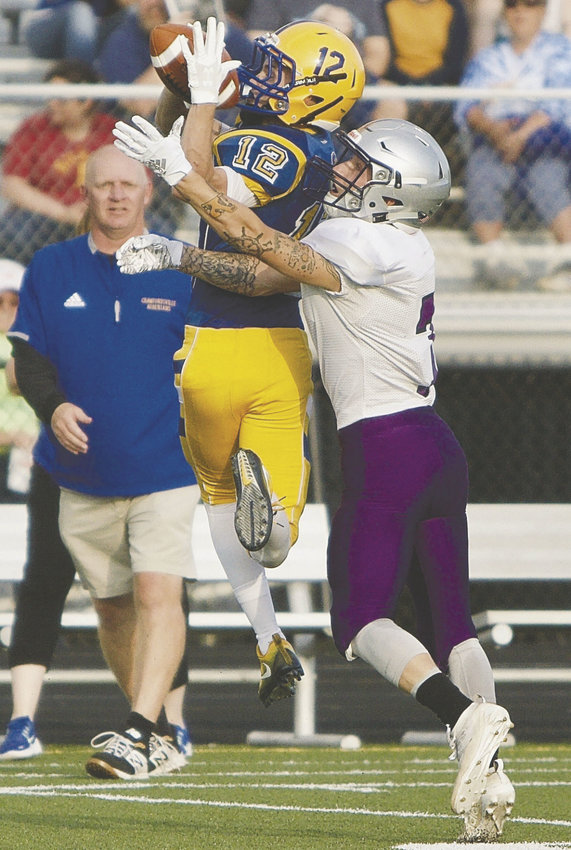 Crawfordsville first-year coach Kurt Schlicher as he looks on at Andrew Martin making a grab.