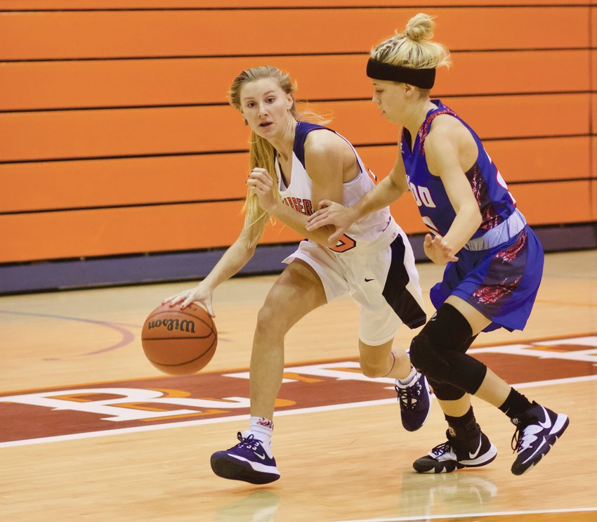Grace McClaskey drives to the hoop in North Montgomery's 54-28 win over Elwood.