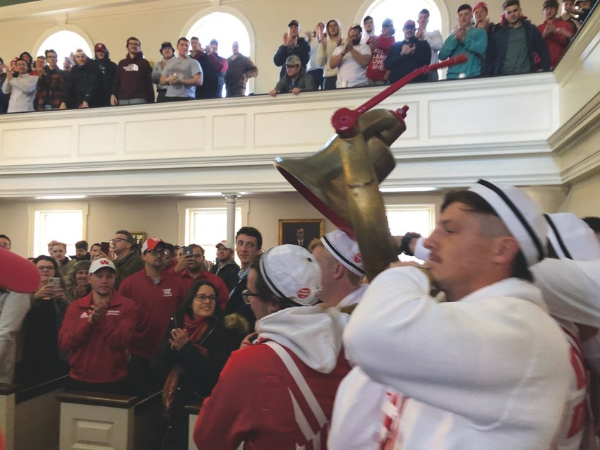 Members of the Wabash Sphinx Club carry the Monon Bell into the Wabash Chapel on Thursday morning for the annual Bell Week Chapel. The Little Giants travel to Greencastle on Saturday for the 126th annual Monon Bell Classic.