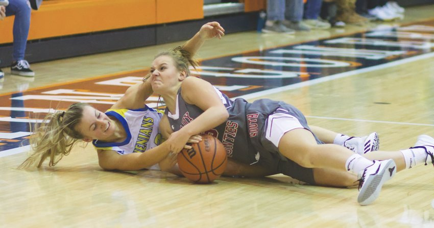 Southmont's Addi Charles and Crawfordsville's Lauren Kellerman battle for a loose ball. Kellerman led all scorers with 23 points, while Charles led the Mounties to a win with 11 points.