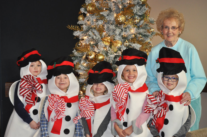 Picutred by the Christmas tree at Wellbrooke of Crawfordsville, are, from left, preschool students Dawson Allen, Maverick Jones, Alizyah Surber, Sophia Hamilton and Sylis Barnett and preschool teacher Pat Harwood.