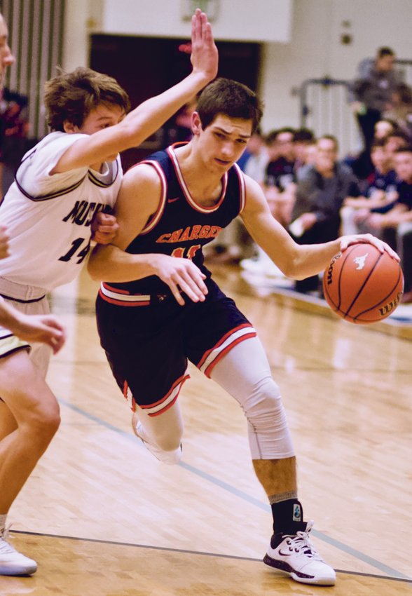 North Montgomery's Jaron Bradford drives to the hoop. He led the Chargers with 14 points in their win over Fountain Central on Saturday.