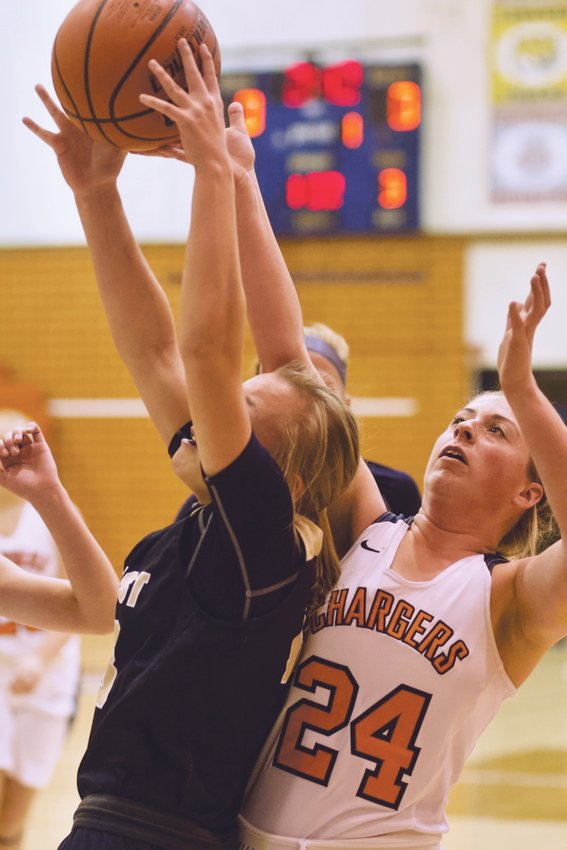 North Montgomery's Sidney Zachary fights for the ball. The senior paced the Chargers with seven points in their 75-21 loss to Tri-West.