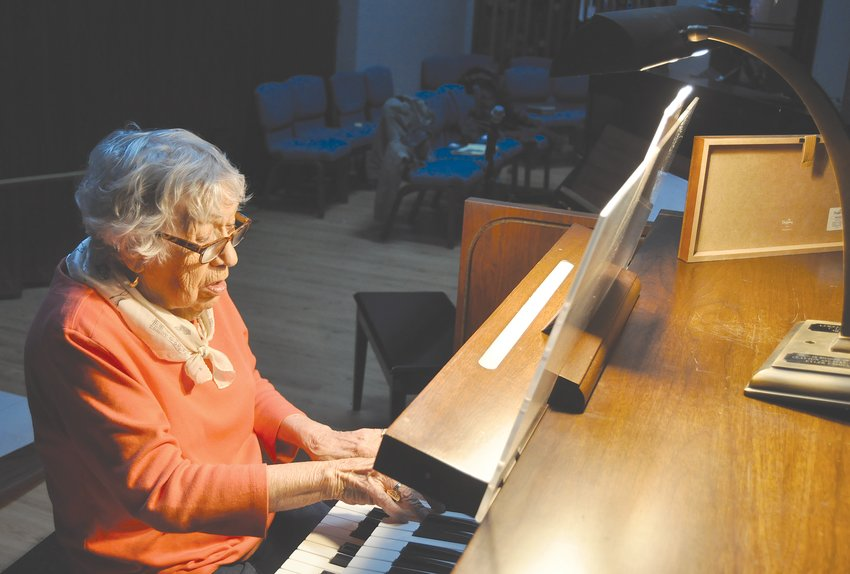 Margy McCafferty plays the organ at St. Bernard Catholic Church. McCafferty retired from playing after nearly 80 years.