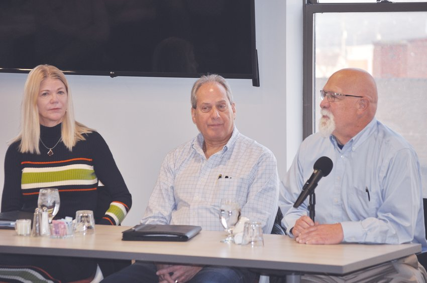From left, State Rep. Sharon Negele, State Sen. Phil Boots and State Rep. Tim Brown listen to a question Saturday at the Crawfordsville/Montgomery County Chamber of Commerce Legislative Breakfast at Fusion 54.